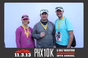 Me, TJ, and Justin (my husband) taking advantage of the finish line photo booth.